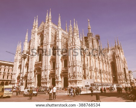 MILAN, ITALY - APRIL 10, 2014: Tourists visiting the Piazza Duomo square in Milan Italy vintage