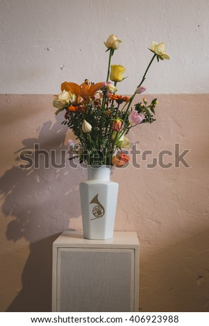 MILAN, ITALY - APRIL 16: Vase with flowers on display at Fuorisalone, set of events distributed in different areas of the town during Milan Design Week on APRIL 16, 2016 in Milan. - stock photo