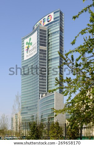 MILAN, ITALY - APRIL 11: view of the building of Regione Lombardia with banners advertising the EXPO 2015  on its facade, shot  on april 11 2015  Milan, Italy  - stock photo