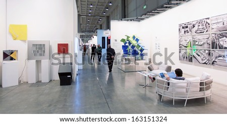 MILAN, ITALY - APRIL 08: Walking trough paintings galleries during MiArt, international exhibition of modern and contemporary art on April 08, 2011 in Milan, Italy  - stock photo