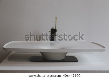 MILAN, ITALY - APRIL 15: Washbasin on display at Fuorisalone, set of events distributed in different areas of the town during Milan Design Week on APRIL 15, 2016 in Milan. - stock photo