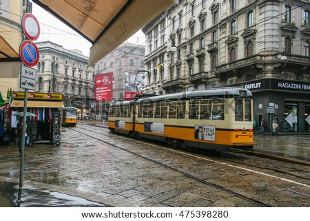 MILAN, ITALY - APRIL 30, 2012 : Yellow vintage tram on the street of Milan nearby Milan Duomo