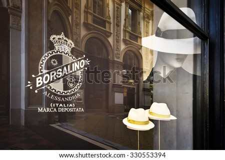 MILAN, ITALY - AUGUST 29 2015: Borsalino golden store window in galleria Vittorio Emanuele II, Milan's fashion district. August, 29 2015.
