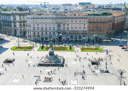 MILAN, ITALY AUGUST 22, 2010 : Tourists walking in Piazza del Duomo in Milan.The square includes the famous Duomo church and the shopping mall Galleria Vittorio Emanuele II. - stock photo