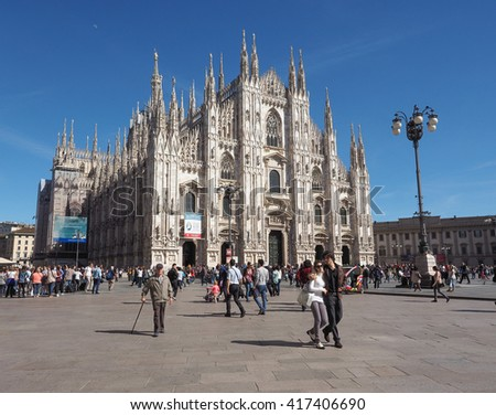 MILAN, ITALY - CIRCA APRIL 2016: Tourists in Piazza Duomo (meaning Cathedral Square) - stock photo