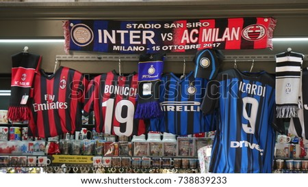MILAN, ITALY - CIRCA OCTOBER 2017: jerseys of Inter and Ac Milan football clubs, the two teams of the city, for sale in a kiosk in the center of Milan, Lombardy, Italy.