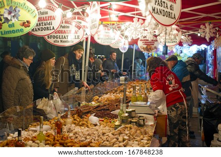 MILAN, ITALY - DEC 10: Christmas atmosphere at the open market in Duomo square , December, 10 2013. - stock photo