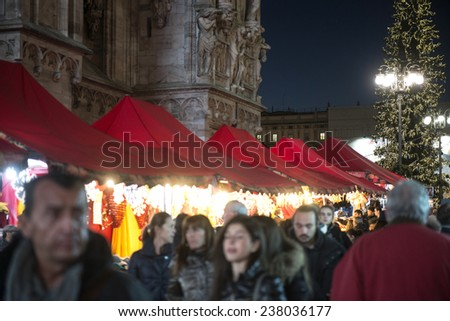 MILAN, ITALY-DECEMBER 09, 2014: christmas market with lights decorations nearby the Duomo cathedral, in Milan.