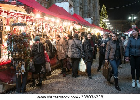 MILAN, ITALY-DECEMBER 09, 2014: christmas market with lights decorations nearby the Duomo cathedral, in Milan. - stock photo
