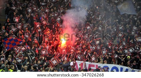 MILAN, ITALY-DECEMBER 01, 2015: Crotone soccer fans waving flags and lighting flares during the Italy Cup match at san siro stadium AC Milan vs Crotone, in Milan. - stock photo