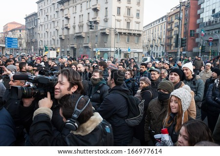 MILAN, ITALY - DECEMBER 11: Demonstrators occupy the city streets blocking the traffic to protest against government and politicians on DECEMBER 11, 2013 in Milan.