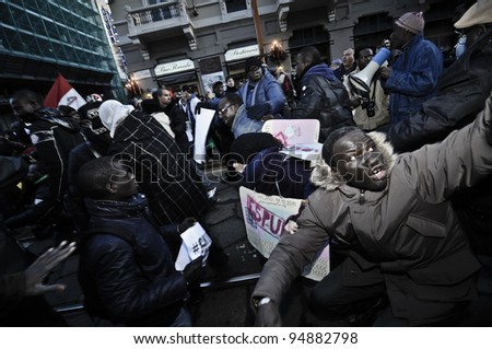 MILAN, ITALY - DECEMBER 17: manifestation against racism in Milan December, 17 2011: A big migrant group of people protest against racism and violence after the killing of their two compatriots