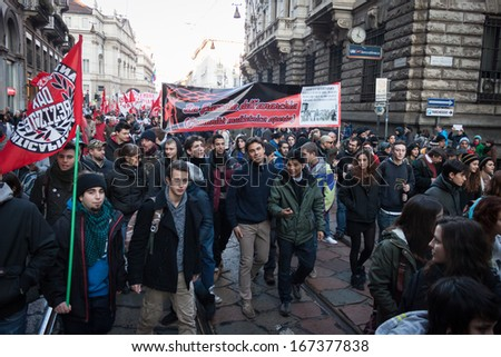 MILAN, ITALY - DECEMBER 14: People participate in an antifascist march to celebrate piazza Fontana bombing anniversary on DECEMBER 14,2013 in Milan.