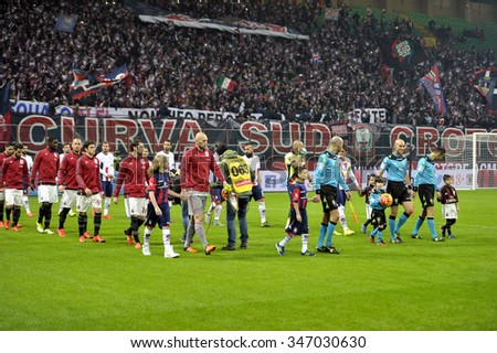 MILAN, ITALY-DECEMBER 01, 2015: soccer players enter at the san siro stadium during the Italy Cup match at  AC Milan vs Crotone, in Milan. - stock photo