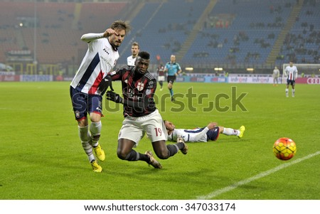 MILAN, ITALY-DECEMBER 01, 2015: soccer players Michele Cremonesi and M'Baye Niang in action during the Italy Cup match at san siro stadium AC Milan vs Crotone, in Milan.
