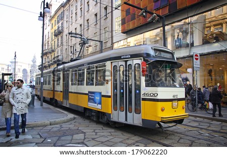 MILAN, ITALY - DECEMBER 31, 2010: Tram (ATM Class 4600) on the street of Milan. Milan tramway network operation since 1881, network is now about 115 km long