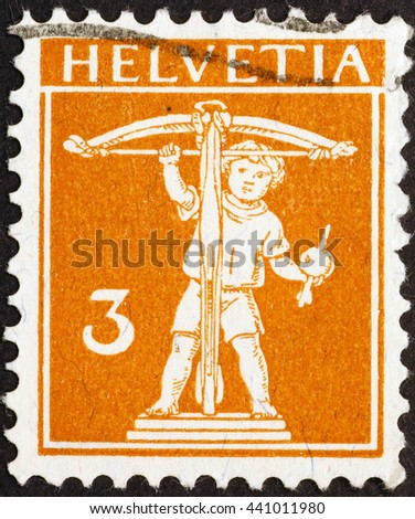 Milan, Italy - December 16, 2014: William Tell's son on swiss postage stamp of 1917 - stock photo