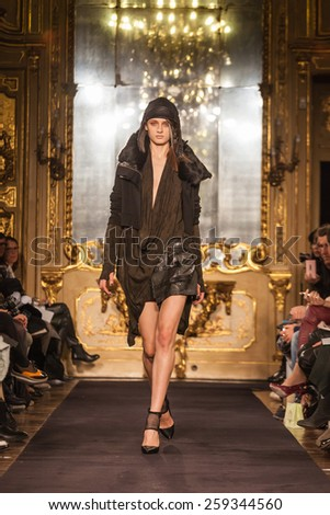 MILAN, ITALY - FEBRUARY 27: A model walks the runway at the Nicholas K show during the Milan Fashion Week Autumn/Winter 2015/2016 on February 27, 2015 in Milan, Italy. - stock photo