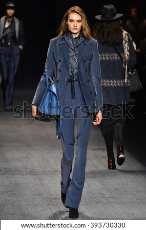 MILAN, ITALY - FEBRUARY 28: A model walks the runway at the Trussardi show during Milan Fashion Week Fall/Winter 2016/17 on February 28, 2016 in Milan, Italy.
