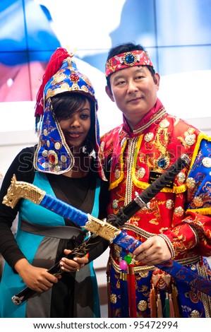 MILAN, ITALY - FEBRUARY 17: An ethiopian girl and a Korean man at BIT International Tourism Exchange on february 17, 2012 in Milan, Italy. - stock photo