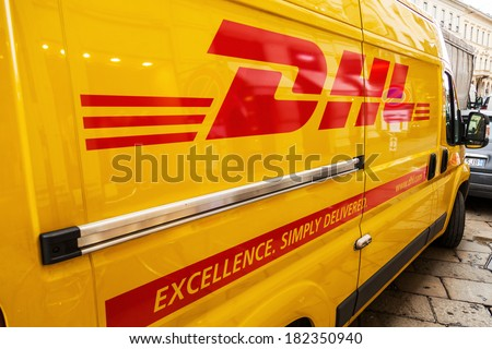 MILAN, ITALY - FEBRUARY 20: DHL transporter on a street on February 20, 2014 in Milan. DHL is the world's top-selling logistics company. - stock photo
