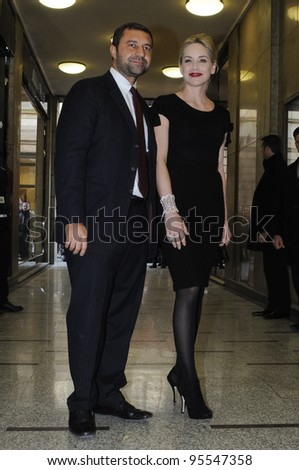 MILAN, ITALY - FEBRUARY 16: Director Damiani and Sharon Stone in Milan on February, 16 2012. Famous Actress Sharon Stone visiting for renewal of Damiani's jewelry in Corso Como. - stock photo