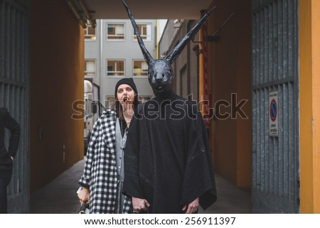 MILAN, ITALY - FEBRUARY 27: Man with rabbit mask poses outside Armani fashion show building for Milan Women's Fashion Week on FEBRUARY 27, 2015  in Milan.