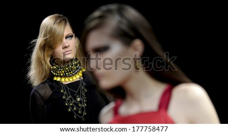 MILAN, ITALY-FEBRUARY 27, 2010: Models runway catwalk during the fall-winter fashion collection of Bottega Veneta.