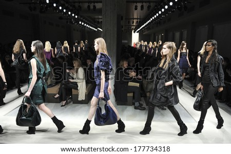 MILAN, ITALY-FEBRUARY 27, 2010: Models runway catwalk during the spring-summer fashion collection of Bottega Veneta. - stock photo
