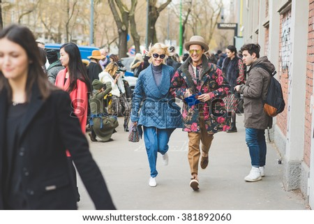 Milan, Italy - February 25, 2016: people attending models and vips in the streets during Milan Fashion Week Women Fall/Winter 2015/2016