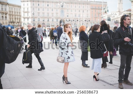 MILAN, ITALY - FEBRUARY 25: People during Milan Fashion week, Italy on February, 25 2015. Eccentric and fashionable people outside city during Milan fashion week wait for models and famous people