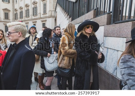 MILAN, ITALY - FEBRUARY 28: People gather outside Gabriele Colangelo fashion show building for Milan Women's Fashion Week on FEBRUARY 28, 2015  in Milan.