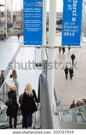 MILAN, ITALY - FEBRUARY 17: People leaving exhibition after visiting BIT, International Tourism Exchange Exhibition on February 17, 2011 in Milan, Italy.