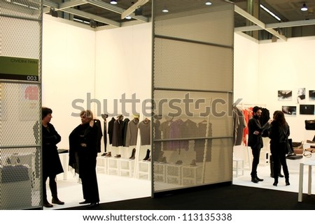 MILAN, ITALY - FEBRUARY 26: People visit accessories and clothes collections at Milano fashion design week February 26, 2010 in Milan, Italy.