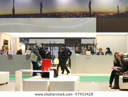 MILAN, ITALY - FEBRUARY 16: People visit Lombardia tourism stand at Italy exhibition area during BIT, International Tourism Exchange Exhibition on February 16, 2012 in Milan, Italy.