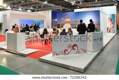 MILAN, ITALY - FEBRUARY 17: People visit Tuscany stand at BIT, International Tourism Exchange Exhibition on February 17, 2011 in Milan, Italy.