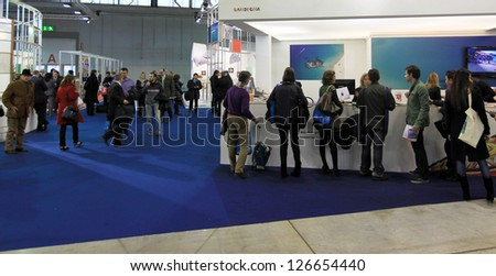 MILAN, ITALY - FEBRUARY 17: People visiting tourism exhibition area at BIT, International Tourism Exchange Exhibition on February 17, 2011 in Milan, Italy. - stock photo