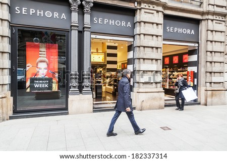 MILAN, ITALY - FEBRUARY 20: Sephora store with unidentified people on February 20, 2014 in Milan. Sephora  is a French brand and cosmetics chain, operates over 1,700 stores in 30 countries worldwide - stock photo