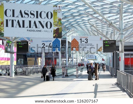 MILAN, ITALY - JAN 24: People on the tapis roulant enter Macef, International Home Show Exhibition on January, 24 2013 in Milan, Italy.