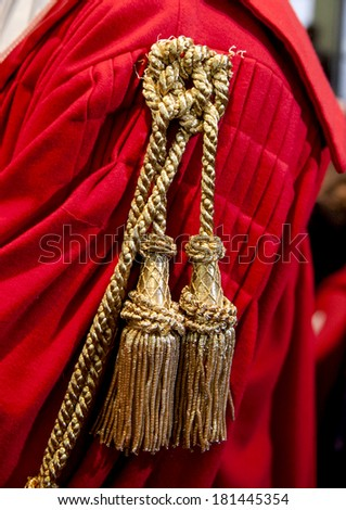 MILAN, ITALY-JANUARY, 28, 2012: Close up of a judge red toga, during the Opening Ceremony of the Justice Year, at the court of law, in Milan. - stock photo