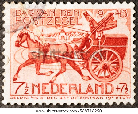 Milan, Italy - January 30, 2017: Old cart on vintage dutch postage stamp