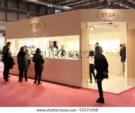 MILAN, ITALY - JANUARY 28: People visit home accessories products stand at Macef, International Home Show Exhibition on January 28, 2011 in Milan, Italy.