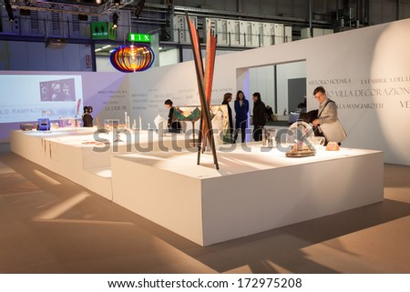 MILAN, ITALY - JANUARY 20: People visit HOMI, home international show and point of reference for all those in the sector of interior design on JANUARY 20, 2014 in Milan. - stock photo