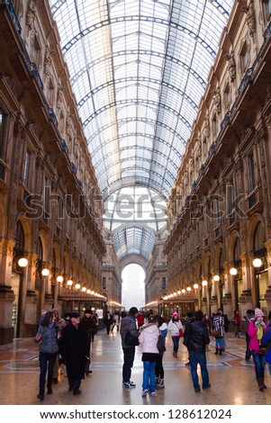 MILAN, ITALY - JANUARY 18: People walking inside the Galleria Vittorio Emanuele - famous shopping gallery with elegant boutiques and fashion creator outlets on January 18, 2013 in Milan, Italy - stock photo
