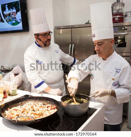 MILAN, ITALY - JANUARY 20: Show cooking at HOMI, home international show and point of reference for all those in the sector of interior design on JANUARY 20, 2014 in Milan. - stock photo