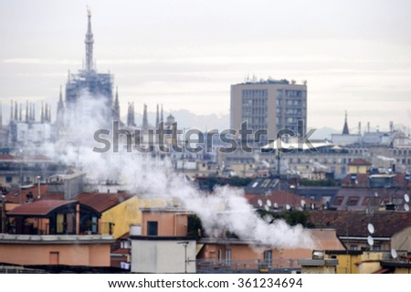 MILAN, ITALY- JANUARY 07, 2016: smoking chimneys are the biggest reason of air pollution , in Milan.