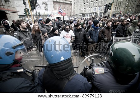 MILAN, ITALY - JANUARY 28: student demonstration held in Milan January 28, 2011. Students protest against Berlusconi's government calling for his resignation from the government.