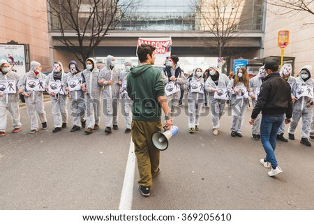 MILAN, ITALY - JANUARY 29: Students march in the city streets to protest agaist the visit of the French politician Marine Le Pen on JANUARY 29, 2016 in Milan. - stock photo