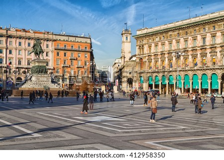 MILAN, ITALY JANUARY 17, 2016 : Tourists walking in Piazza del Duomo in Milan.The square includes the famous Duomo church and the shopping mall Galleria Vittorio Emanuele II. - stock photo