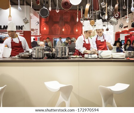 MILAN, ITALY - JANUARY 20: Young cooks work on their recipes at HOMI, home international show and point of reference for all those in the sector of interior design on JANUARY 20, 2014 in Milan. - stock photo